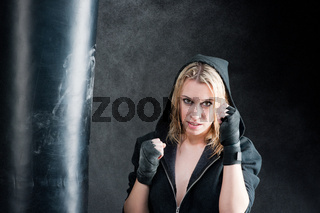 Boxing training woman in black grunge background