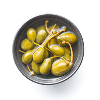 Pickled caper berries in bowl.