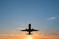 airplane on sunset sky , aircraft silhouette scenic sky