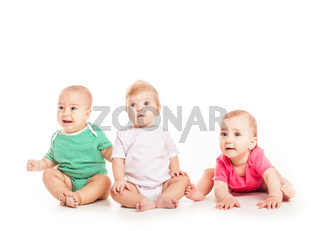 Three babies sitting