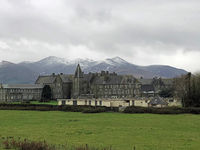 Snow on the hills with old buildings in front