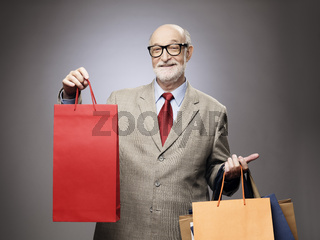Senior man with shopping bags