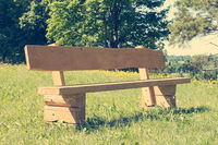 Empty wooden bench at park.