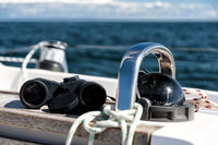 compass and binoculars on a sailing yacht
