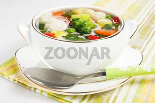 Soup with chicken meatballs and fresh vegetable