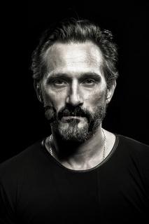 Monochrome portrait of strong mature beardy man.