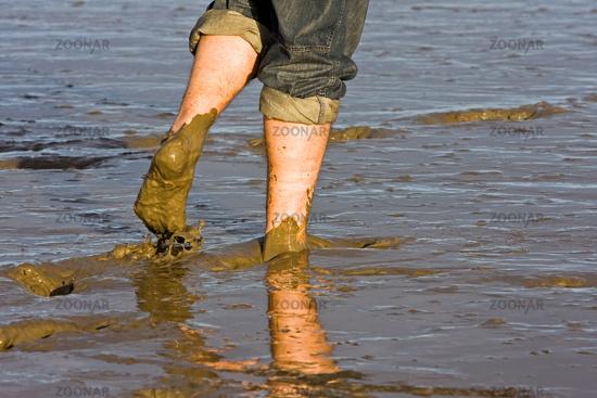 naked feet in mudflat