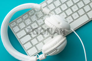 White headphones and computer keyboard.