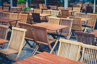 empty tables and chairs in restaurant on day off