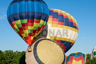 Colorful hot-air balloons ready to get up in flight