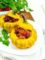 Squash yellow stuffed with meat on board