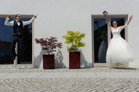 Joyful jumping fresh married couple