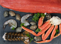 Freshly prepared seafood on natural slate rock