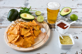 Nachos with sauces beer and avocado