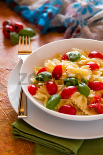 Farfalle pasta with cherry tomatoes and basil