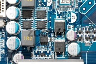Closeup of a circuit board with many electrical components