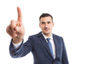 Modern businessman touching invisible screen or display