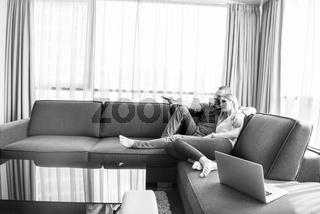 happy couple relaxes in the living room