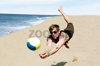 Poto Of A Young Man In A Dynamic Jump Hitting A Volley Ball