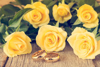 Wedding rings with yellow roses