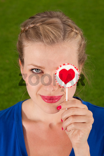 beautiful girl with lollipop heart in her hand