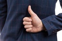 Business like or thumb-up gesture behind back