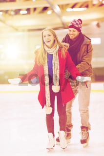 happy couple on skating rink