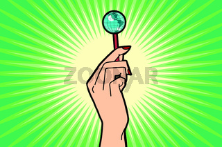 Earth Lollipop in female hand
