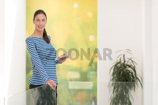young woman at home websurfing