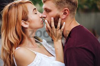 beautiful couple posing outdoors, close view