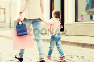 close up of mother and child shopping in city