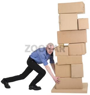 Man pushing pile from cardboard boxes