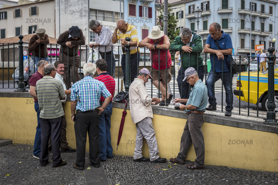 Senior citizens playing cards in Funchal