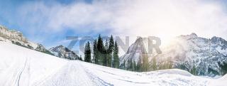 Alpine road through the snow