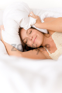 Bedroom - lazy woman getting up blocking ears