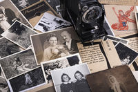 Nostalgic photographs with historical film bags and roll film camera, genealogy