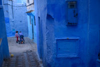 Kids in Chefchaouen, the blue city in the Morocco.