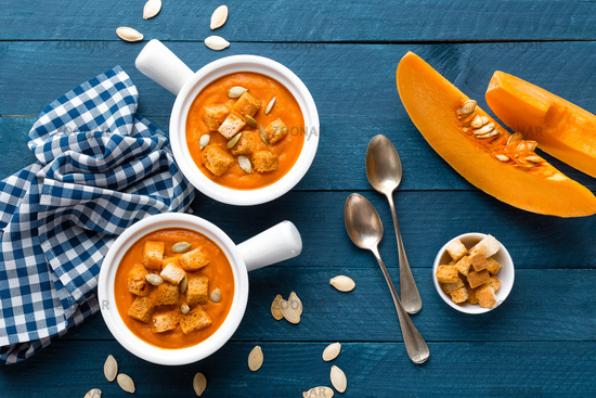 pumpkin soup in bowls on table