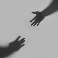 Two hands are drawn to each other