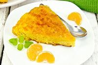 Pie mandarin with mint on light board