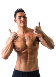 Muscular man shirtless doing thumb up sign for OK, smiling