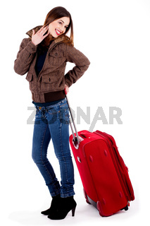 young lady standing with travel bag on an isolated background