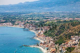 view of Giardini Naxos town on Ionian Sea beach