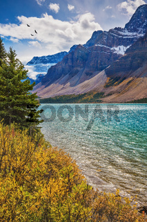 The azure lake surrounded by  Rocky Mountains