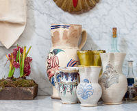 Ceramic jugs on the marble-topped kitchen