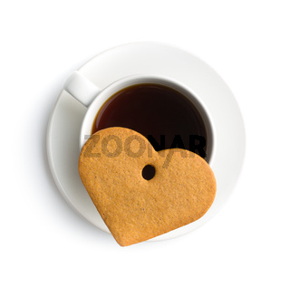 Gingerbread heart and cup of coffee.