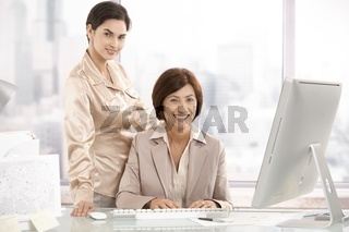 Portrait of senior executive woman with assistant