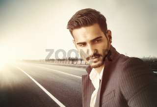 Stylish man on a road