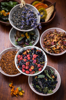 Assortment of herbal and fruit tea in bowls