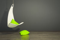 hanging armchair with green pillows
